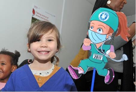 Girl with cartoon doctor