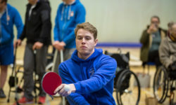 Patient Oliver Carpenter playing table tennis