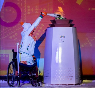 Ali Jawad lighting the Paralympic Cauldron