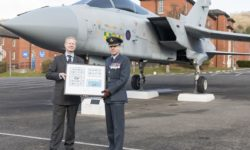 Ben Glazier designed the Postage Stamp for the Isle of Man to Commemorate RAF100. The presentation was to   Stn Cdr Gp Capt Brayshaw.