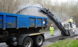 Road repairs: a 'plane and patch' team resurface a small section of road