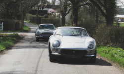 A Ferrari leads an Aston Martin in one of the company shoots