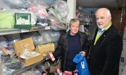Carol Sampson, Operations Director at Sports Traider and Noel Brown begin the clear out of fake and seized goods.