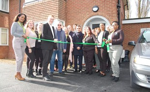 Cutting the ribbon as the care home opens