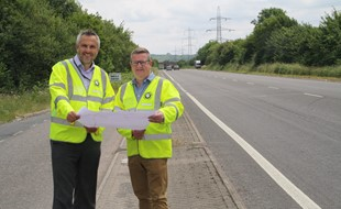 Mark Shaw and Kevin Allen look over the plans