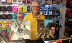 Danny Prendergast with a couple of Beatles LPs on sale in the shop