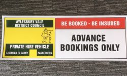 An AVDC taxi plate